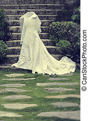 Wedding Gown Vintage - White wedding gown shot in a garden