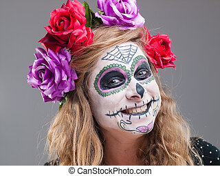 Halloween witch Beautiful woman wearing santa muerte mask...