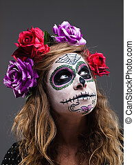 Halloween witch. Beautiful woman wearing santa muerte mask...