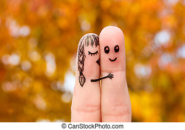 Finger art of a Happy couple Girl kisses boy on the cheek
