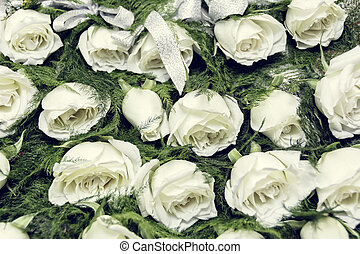 White Rose Boutonniere - Rows of white rose boutonniere for...