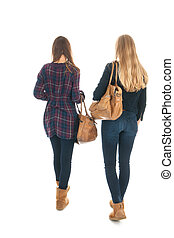 Schoolgirls with school bags - school girls walking at...