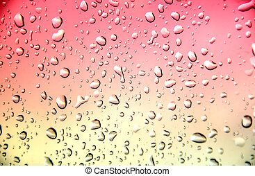 Drop water - abstract red color texture background with drop...