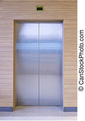 elevator - Elevator door with wood wall.