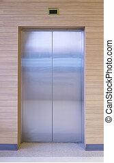 elevator - Elevator door with wood wall.