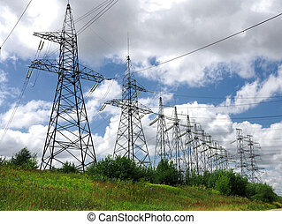 Electric power lines on a blue sky background Electrical...