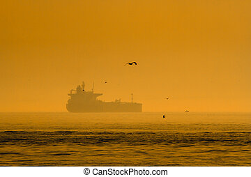 Ship Silhouette at Sunset - Ship silhouette at sunset on the...