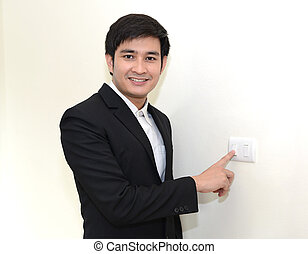Asian handsome business man Turning off or turning on the...