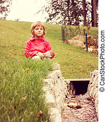 thoughtful girl - young thoughtful sitting in park at the...