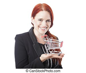 Young redhead woman holding a shopping cart - Young redhead...