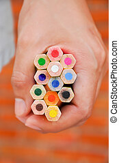 Colour pencil - A brightly colored pencils in her handful