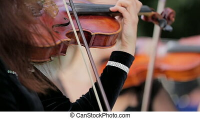 Two Women Playing Violon - Footage of two women playing the...