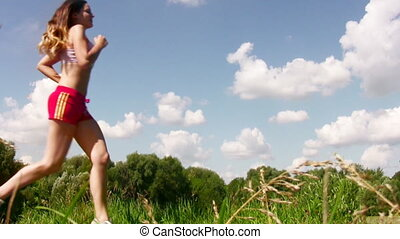 sport woman running on sky