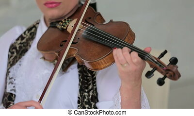 Woman Playing the Violon - Footage of one woman in white...
