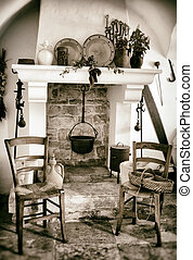 Old fireplace used for cooking inside a trullo in...