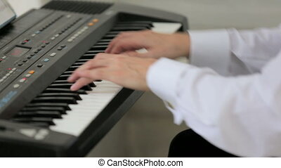 Musician Playing Keyboard - Close-up shot of professional...