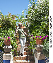 woman on a background of flowers to Spain Ronda