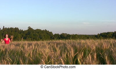 woman running in wheat field