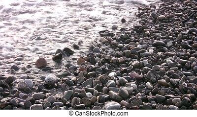 sea backwater on stones