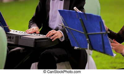 Musician Playing Keyboard At Band - Close-up front shot of...