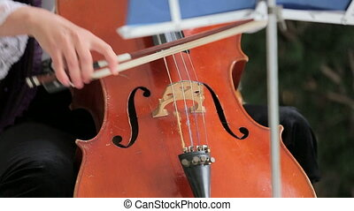 Woman Playing th Violoncello - Close-up shot of a...