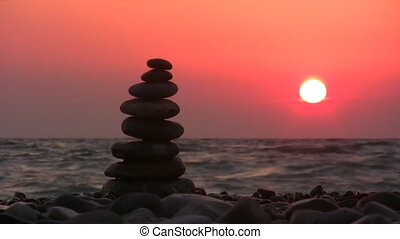 pyramid on beach with sun