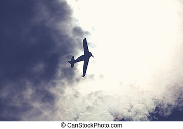Fighter plane on cloudy sky - Old fighter plane on bright...