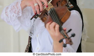 Woman Expressively Playing the Violin