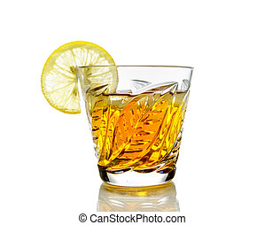 Crystal glass with alcohol and a slice of lemon, isolated on...