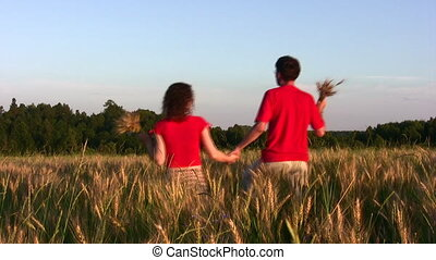 behind couple in wheat field