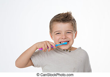 oral care example - funny kid enjoys his toothbrush