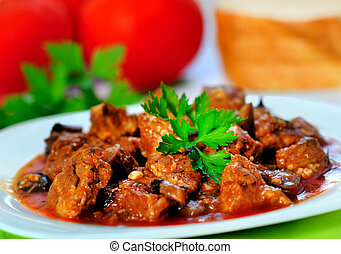 Pork meat stew - Plate with stew of pork meat