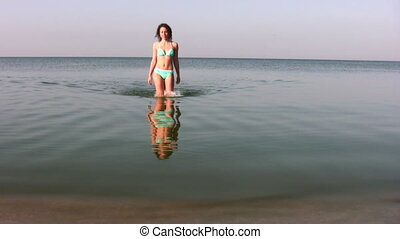 woman walking on water