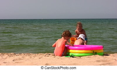 group children play on beach