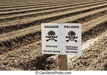 Danger Pesticide Sign In Field - danger pesticide sign in...