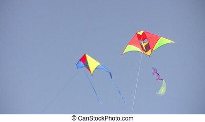 two kites on sky