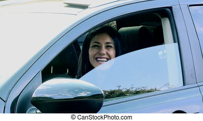 Happy woman saying hello from car - Business woman smiling...