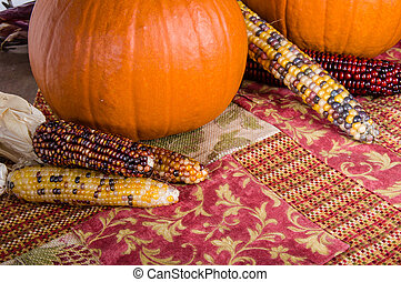 Fall display of orange pumpkins and corn - Fall display of...