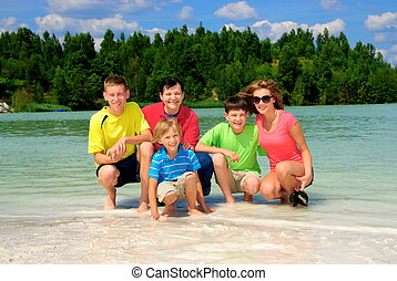 Family by green lake