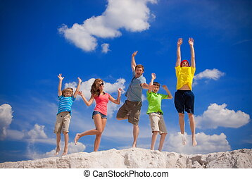 Family happy jump - Family of five are jumping high on the...