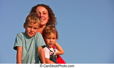 mother with children faces on sky - Mother with children...