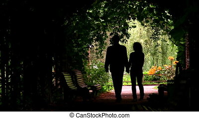 couple silhouette in plant tunnel