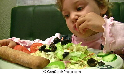 little girl eat salad - Little girl eat salad