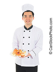 asian chinese male chef holding foods