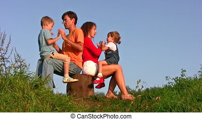 family of four play okey-dokey - Family of four play...