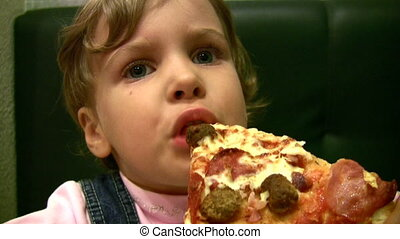 little girl eat pizza