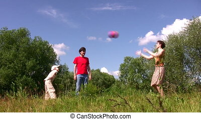 Family with boy play ball