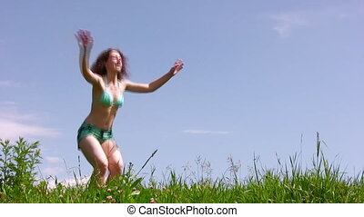 Training woman on grass