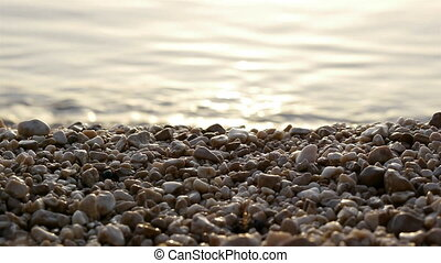 Pebble beach and sea - Pebble beach and calm sea background