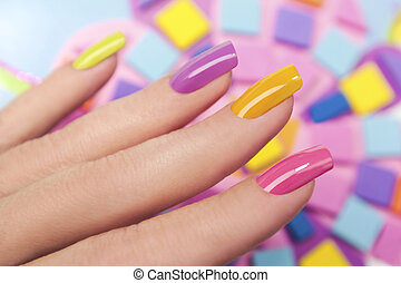 Solar nails. - Solar nails are covered with multi-colored...